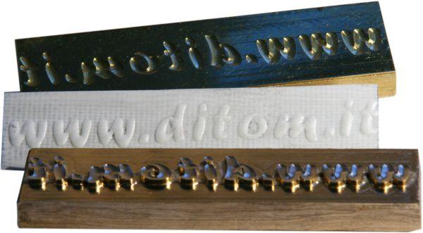 ottone e materiali termoindurenti per rilievo e doratura a caldo